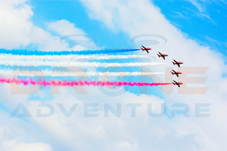 The World famous display team, The Red Arrows.  Using the iconic red Hawk aircraft from the British Royal Air Force (RAF).