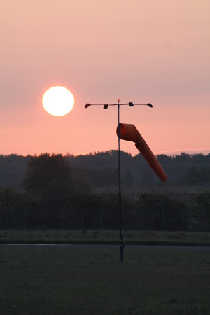 A view of an airport windsock.  This gives pilots an indication of which direction the wind is going so they can adjust their angle when landing and taking off.