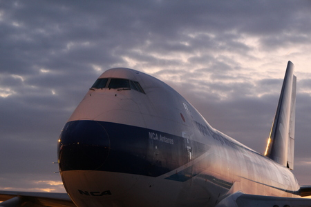 A huge Boeing 747 aircraft, one of the worlds most beautiful aircraft with its 2 deck airframe.