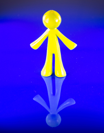 A plastic figure of a man standing tall. Stock Photo