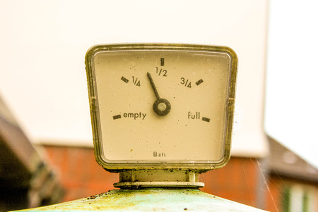 litre: The guage on top of a home heating oil tank indicated how much oil is left inside.