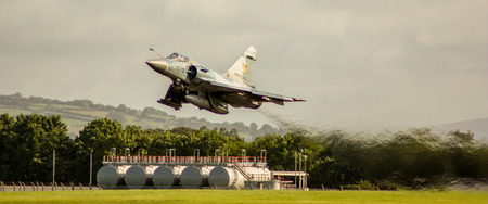 A supersonic jet from the French Air Force, taking off from a UK airport.