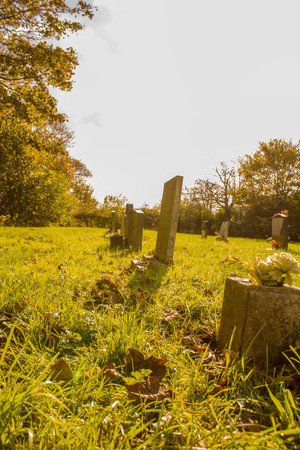 A typical British graveyard in the morning sunlight. Stock Photo