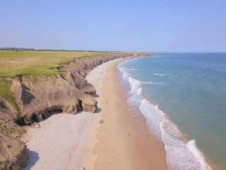 A shot of a typical British beach coastline taken from a drone.