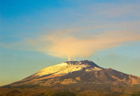 A wide angle image of Mount Etna, Sicily.  The World famous landmark Volcano sits active above the towns and cities below.