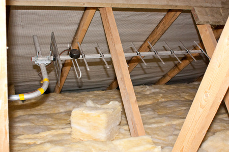 A view of attic insulation within a typical household. Фото со стока