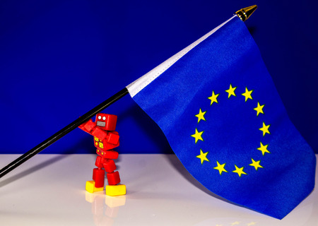 A robot struggles to re-raise the European flag. Stock Photo