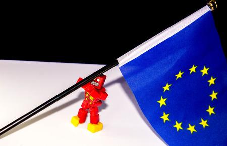 A robot struggles to re-raise the European flag. Stock Photo