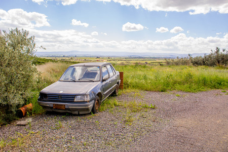An abandoned car in the outback of Sicily, Italy.