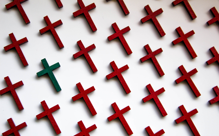 A collection of wooden crosses to depict the loss of life.