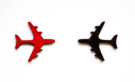Black and red aircraft seen from above to signify anti collision or airspace traffic.