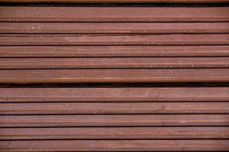 A closeup view of brown decking boards.