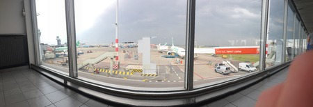 June 08, 2018 – Schipol Airport, Amsterdam. Schipol Airport is one of the busiest and largest airports in the work. Here is a panoramic taken from one of its busy terminals, looking out onto the taxiways and gates.