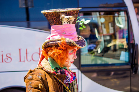 May 20, 2018 – Camden Lock, England, United Kingdom. One of the local street artists, dressed as the 'Mad Hatter' in the streets of Camden Lock.