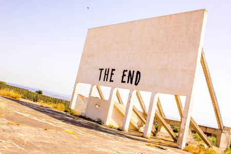 Sicily, Italy. An old drive through cinema in the outdoors of Sicily, now sits derelict with only wise words to show The End