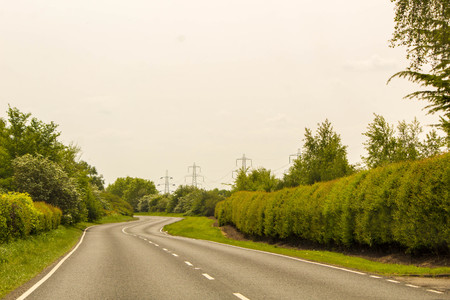 A typical open road in the countryside of the United Kingdom.