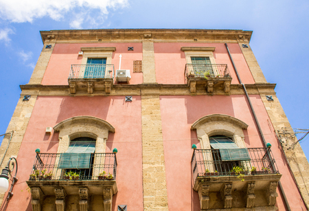 A view from the ground up of an old building in Sicily, Italy.