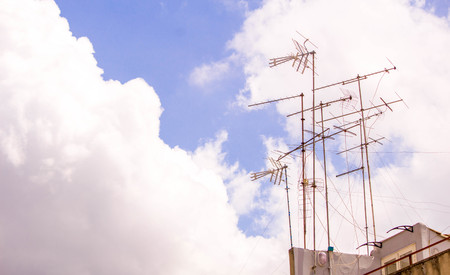 Several TV aerials on rooftops.
