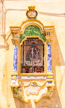 A traditional wall saint  prayer location in Sicily, Italy. Stock Photo