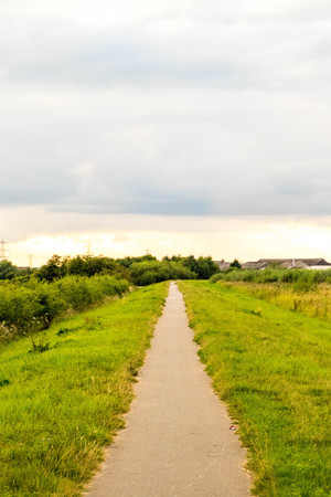 An empty canal path disappearing into the distance. Stock Photo