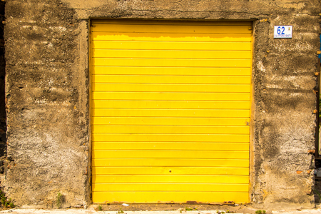 A set of double garage doors, closed and locked.