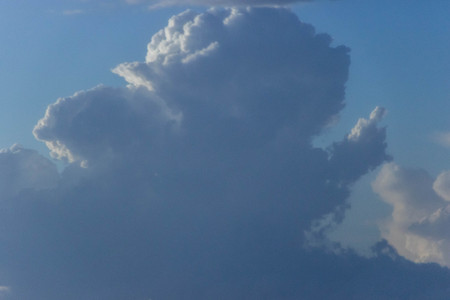 A view across the skies at fluffy clouds forming.