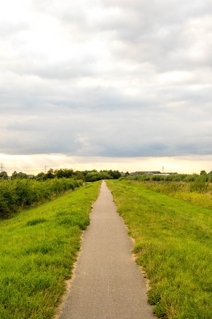 An empty canal path disappearing into the distance. Reklamní fotografie