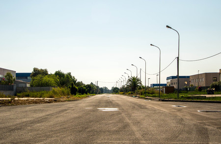 A typical Italian road, within an industrial area, in Sicily.