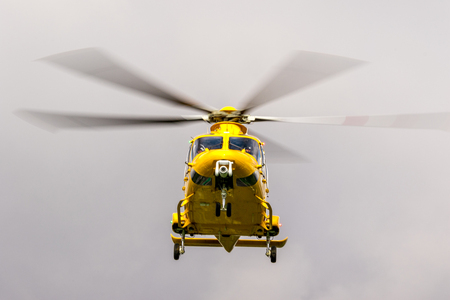 The East Midlands Air Ambulance airlifting a patient to the nearest hospital.