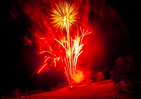 A spectacular fireworks display on the hillside of Cadwell Park, UK. Stock Photo