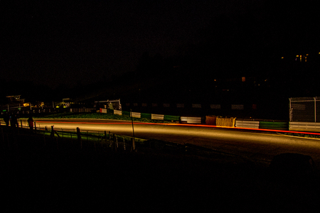 A rally undertaken on a racetrack, carried out at night / dusk.