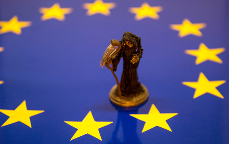 The grim reaper stands on the EU flag to represent the death of the United Kingdom within the EU.