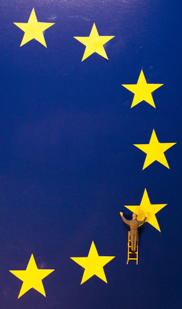 A painter addsremoves the UKs yellow star from the EU flag.