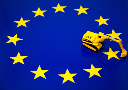 A digger ready to dig out a star from the EU flag.