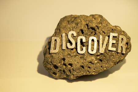The word Discover on a rock surface to show the findings of any item really whether it be historic, treasure or for fun.