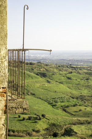 A very old and weak balcony still with a spectacular view of italy. Stock Photo