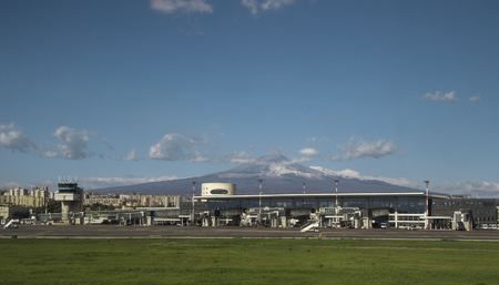 Catania Airport, in Sicily, seen with Mount Etna in the far distance, behind.