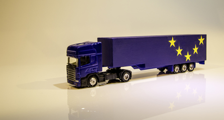 A typical articulated lorry shown in the colour dark blue with the word 'Brexit' on the side. Goods looking to be just one of the issues of Brexit.