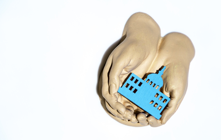 A pair of cupped hands hold and care for property.