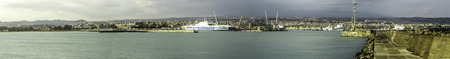 A panoramic view of Catania Harbour, in Sicily, Italy. Behind in the distance is Mount Etna, one of the worlds most active volcanos.