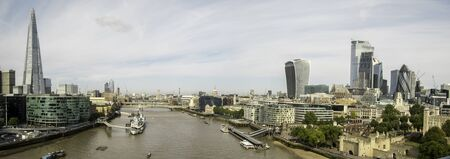 A typical view of the famous London skyline and its huge buildings that engulf the area filled with businesses and apartments. Stock Photo
