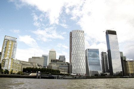 A typical view of the famous London skyline and its huge buildings that engulf the area filled with businesses and apartments. Editorial