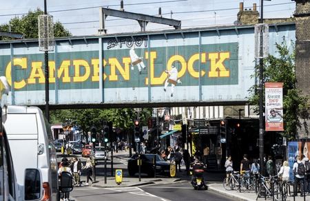 August 18, 2019 – Camden Lock, London, United Kingdom. Tourists flock to Camden Lock for its shops and stalls that surround the area. Unique items sold everywhere. Editorial