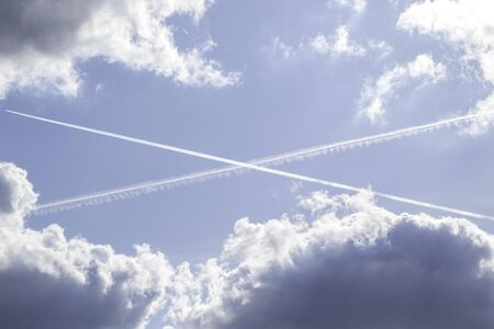 Two passenger plane trails cross in the sky, making it look like a giant Scottish St Andrew's flag.