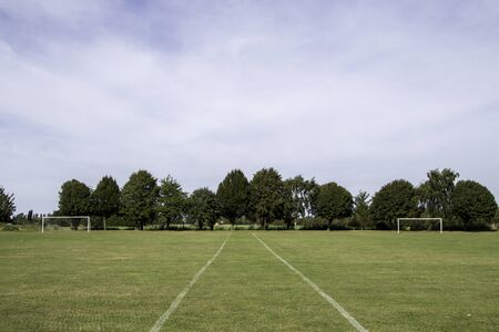 A view of a typical sports field, viewed empty, where many young and old go to play the likes of football and rugby.