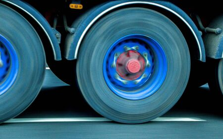 A closeup of wheels in motion from an articulated lorry, traveling along a UK motorway. Reklamní fotografie