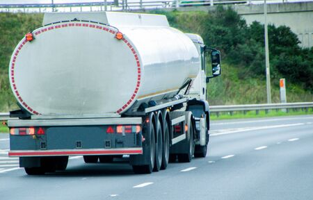 A lorry transporting dangerous goods, fuel, traveling along a main UK motorway.