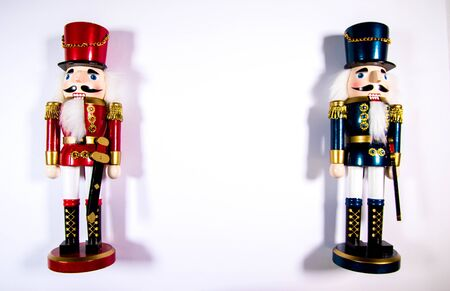 Two colourful Christmas Nutcracker decoration statues on a white background.