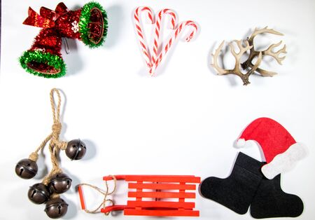 Various festive items representing Christmas seen from above on a tabletop.