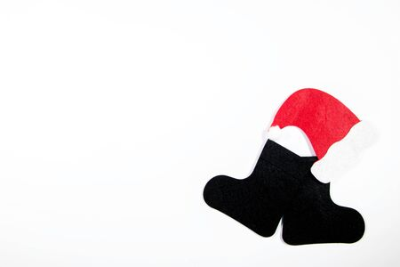 Boots and Hat belonging to Santa Clause, against a white background.